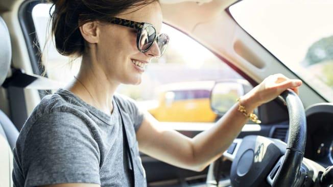 woman millenial driving