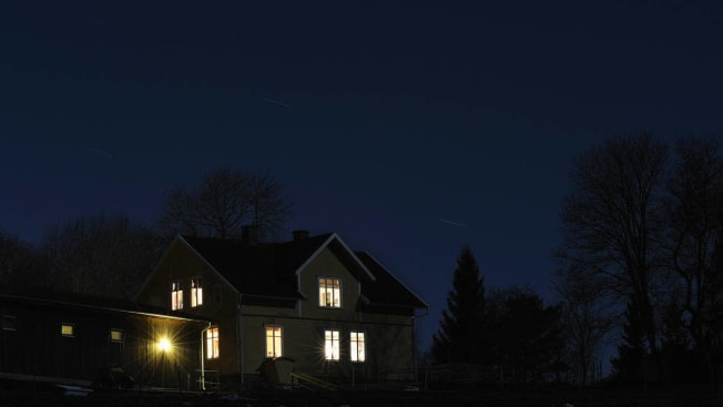 house lit up at night