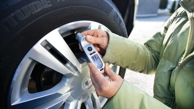 Tire pressure gauge being used