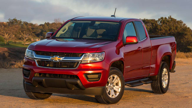 red 2018 Chevrolet Colorado parked on dirt road