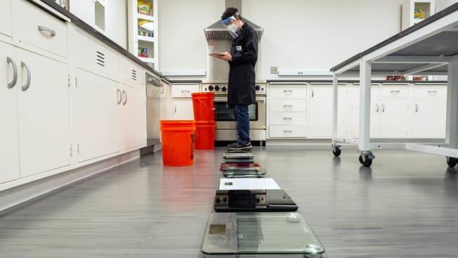 tester testing bathroom scales