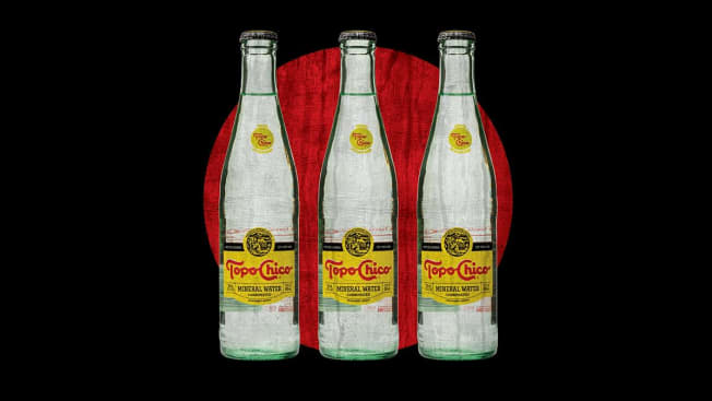Illustration of three bottles of Topo Chico lined up on black and red background
