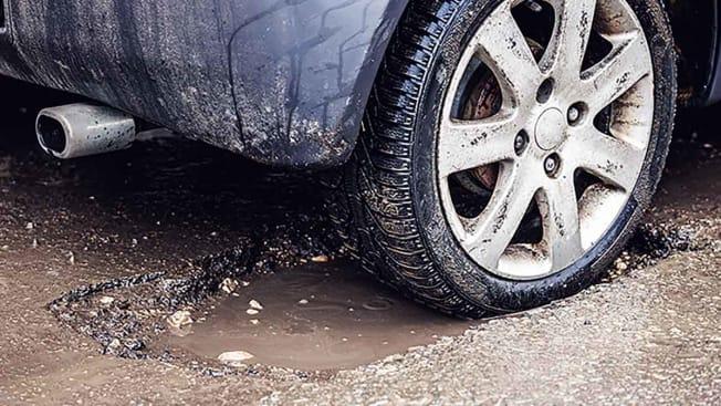 Tire car pothole