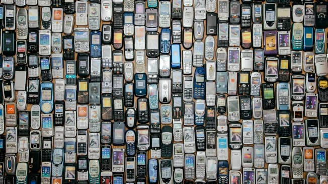 grid of old cell phones
