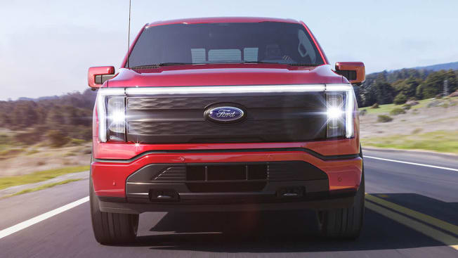 A red 2022 Ford F-150 Lightning front view with grille