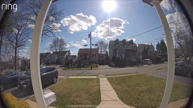 A still from footage shot by a Ring video doorbell of a suburban neighborhood.