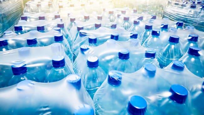 Sealed cases of bottled water.