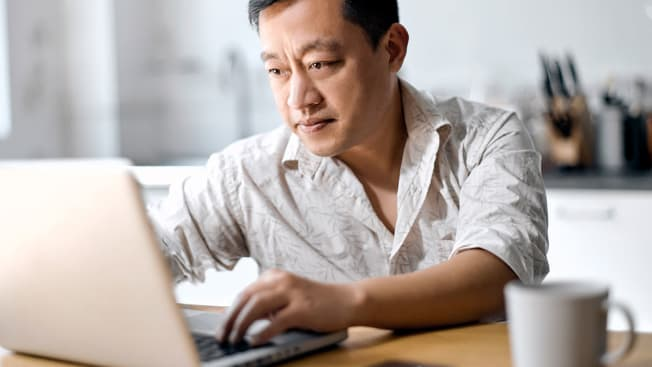 A person using a laptop.