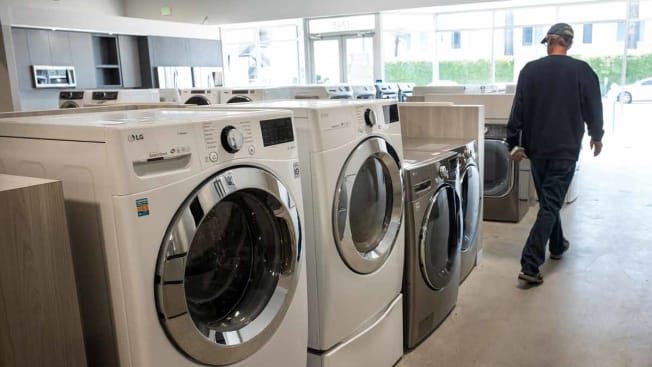 A customer views washing machines displayed for sale at an Appliance store