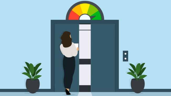 A person walking with paper in hand towards an open elevator door with credit gauge level above it