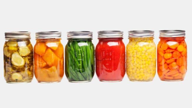 jars of different pickled vegetables lined up