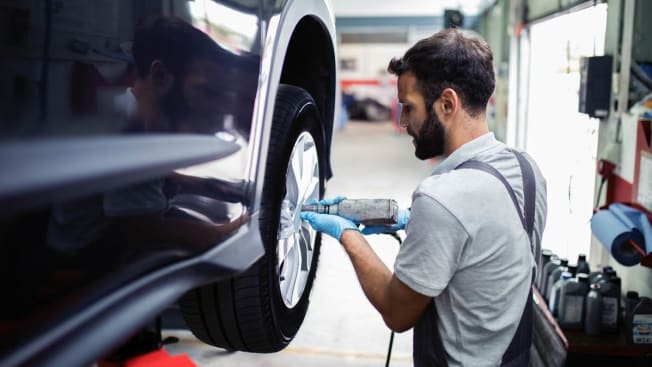 Mechanic putting a new tire on a car