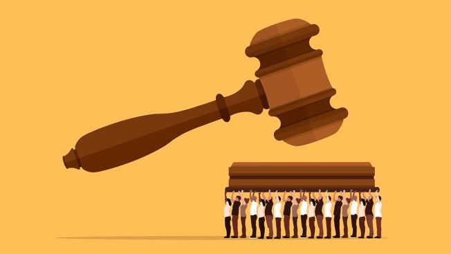 Illustration of a gavel coming down on a block that's being held up by numerous people.