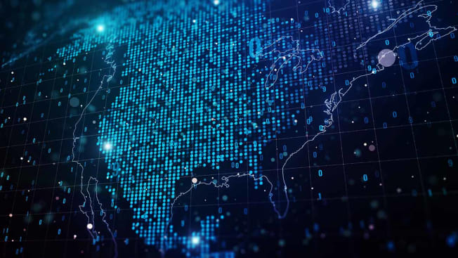 United States map made up of digital lights and binary code.