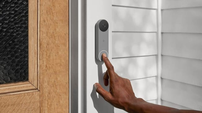 Person ringing a Nest security camera doorbell