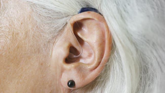 older woman with modern smaller hearing aid