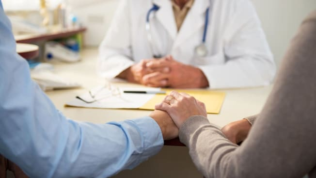 couple at doctors office getting bad news