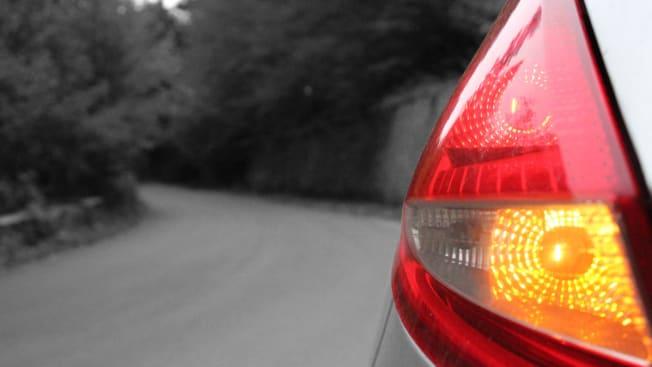 back of car, lights on road