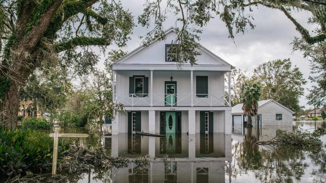 Floodwater surrounds a home on August 31, 2021 in Barataria, Louisiana.