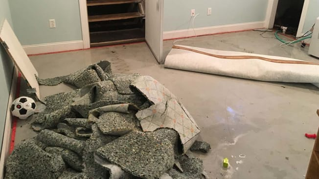 Flooded basement and torn up carpet