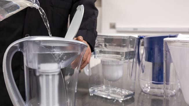 A Consumer Reports employee testing water filter pitchers