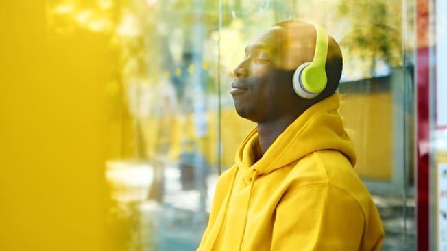 Person listening to headphones