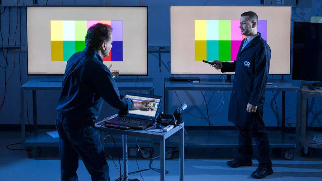 Consumer Reports technicians testing televisions