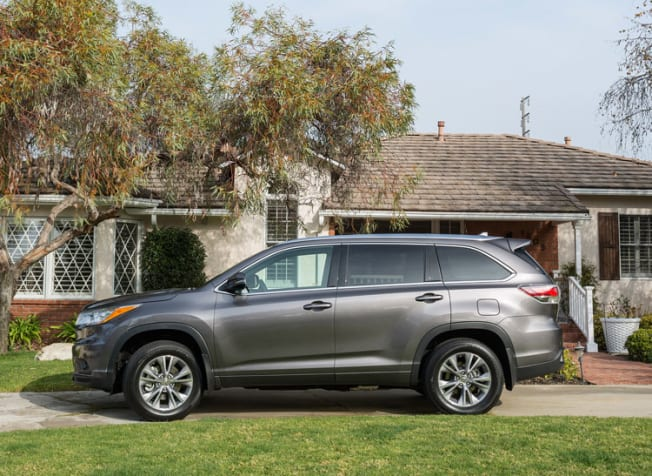 grey 2015 Toyota Highlander parked in front of a house