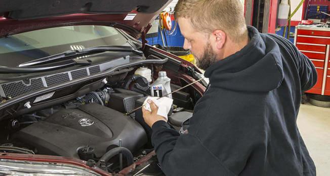 Chris Jones Checking Oil