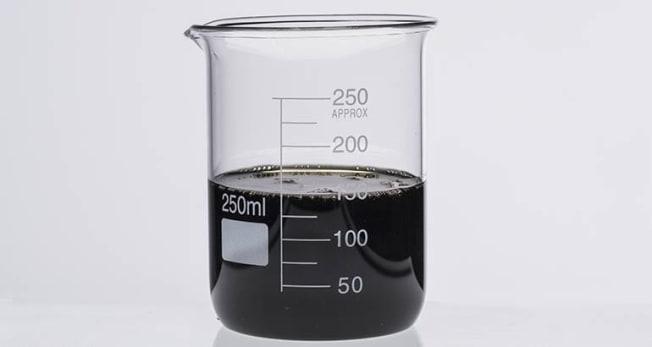 Used oil in a beaker