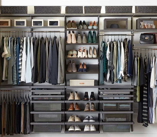 Inside of a closet neatly organized with Elfa products