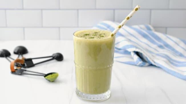 A matcha milkshake in a glass