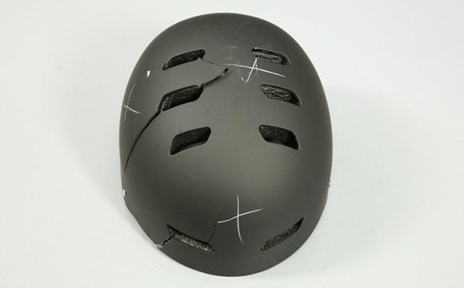 photo of black cracked helmet