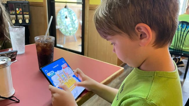 Child playing with Samsung Fold