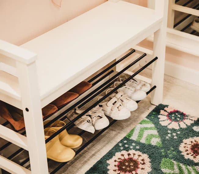Children's bench with shelving for shoes.
