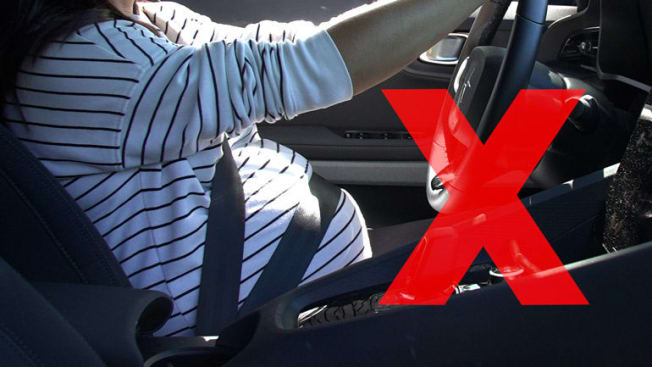 """Red """"x"""" over photo showing wrong way to wear seatbelt while pregnant"""