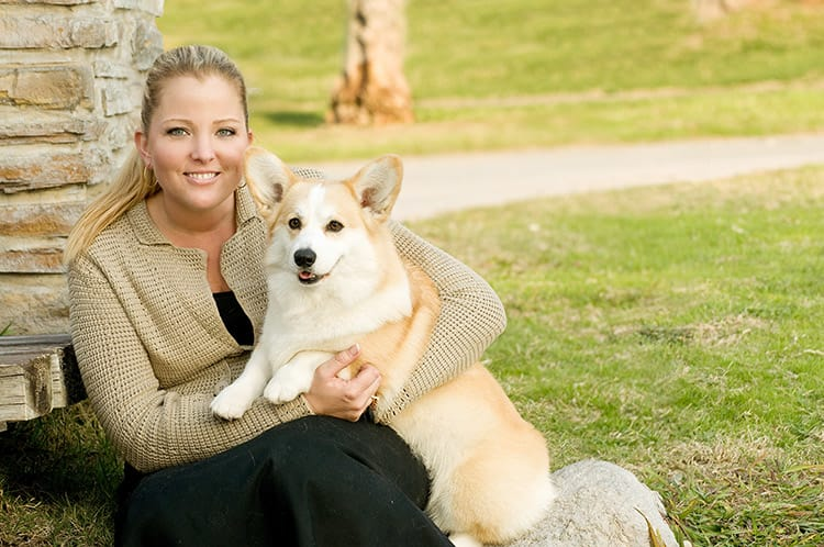 A corgi named Molly posed on the lap of its owner Jenny.