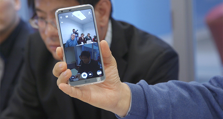 Closeup shot of LG's G6 smartphone's display showing a split-screen view in camera mode