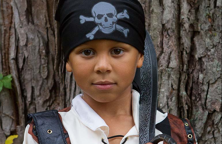 A young boy dressed as a pirate.
