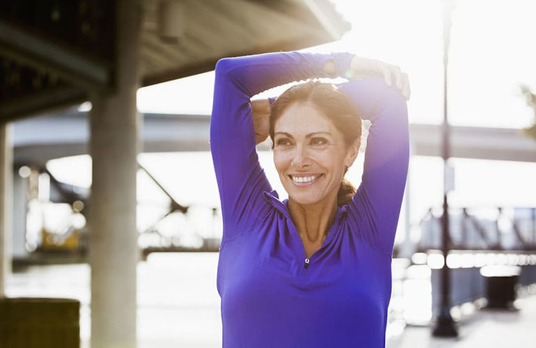 Women's Healthcare: A middle-age woman stretching