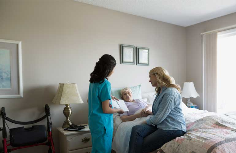 A daughter hires in-home help to care for her elderly mother.