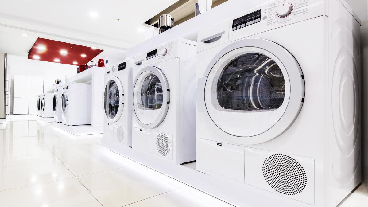A Row Of Washing Machines In Are Shown