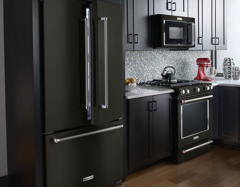 Kitchen with black stainless appliances.