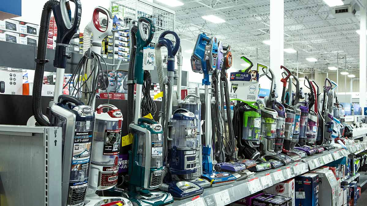 Store shelf stocked with upright vacuums