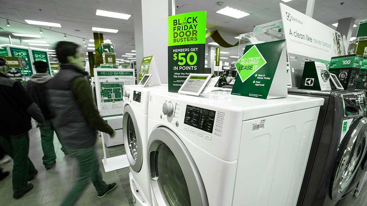 Shoppers check out Black Friday deals on washers and dryers.