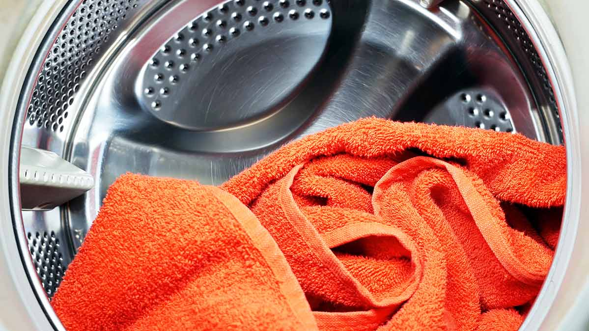 An orange towel in an appliance.