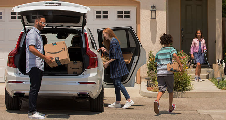 Family taking Amazon package from car