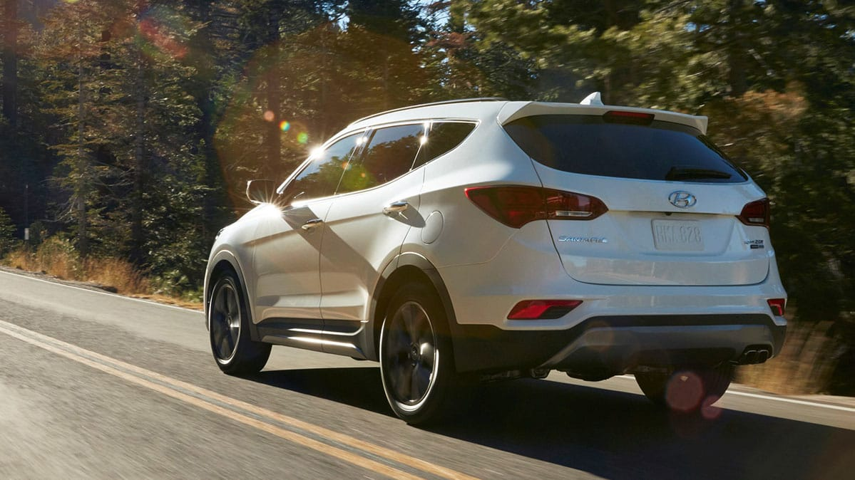 A White Hyundai Santa Fe Sport Suv