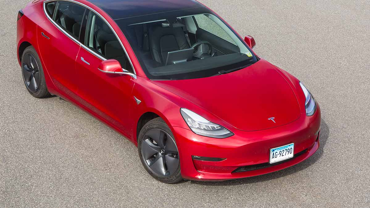 The Tesla Model 3 Ev In Red An Electric Vehicle