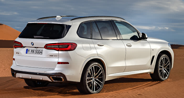 2019 BMW X5 rear three-quarter view.